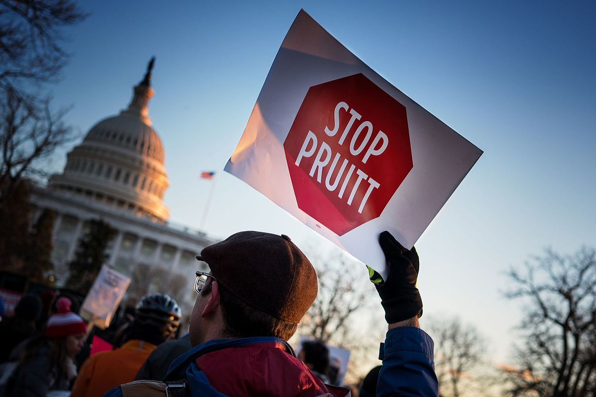 A man protesting the appointment of former EPA chief Scott Pruitt