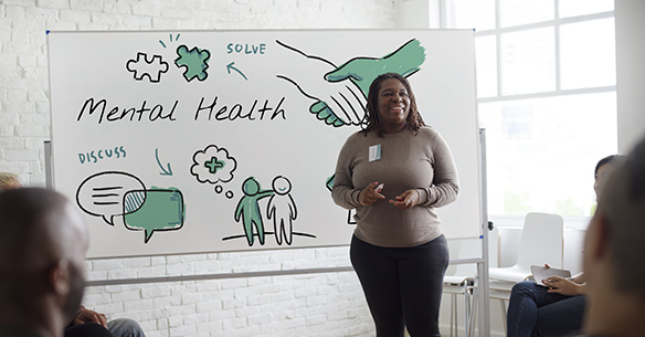 woman with whiteboard supervising first aid for mental health