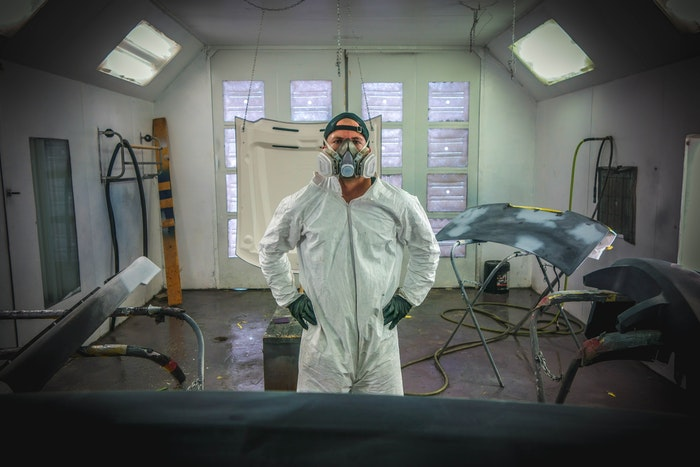 man with breathing mask and ppe