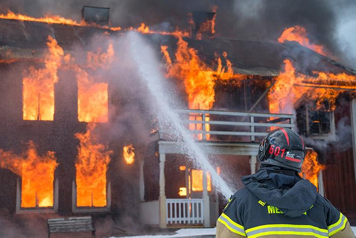 man fighting fire in safety gear