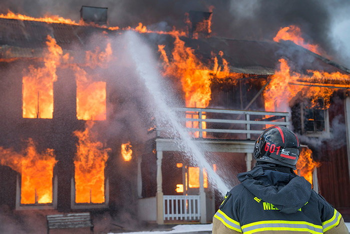 man fighting fire in safety gear