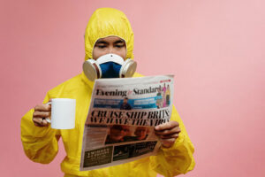 man in ppe with cup of tea coronavirus protection