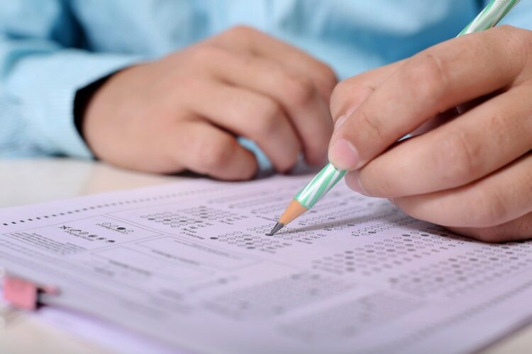 man taking exam with pencil