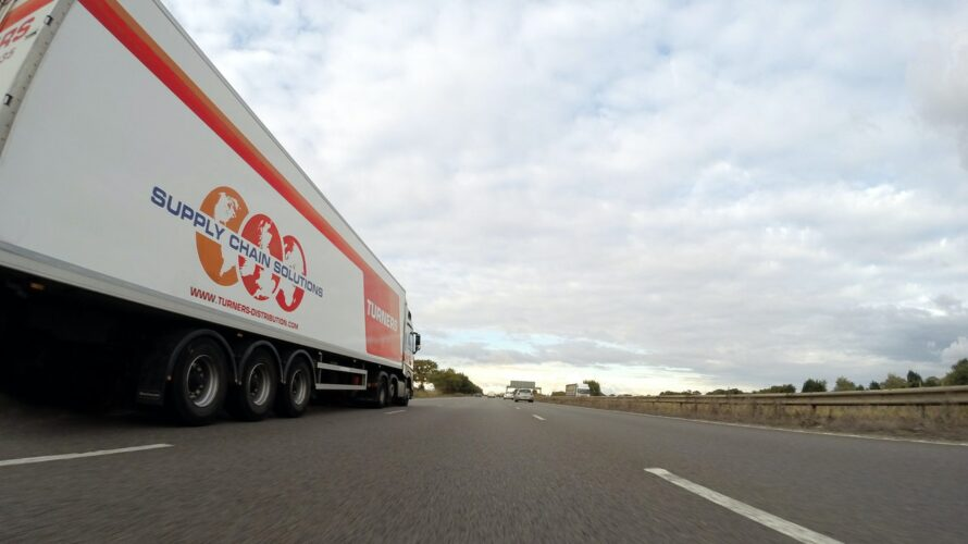 HGV truck driving on road